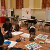 Students making posters for the March for Science and People's Climate March