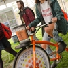 UMass Amherst student pedaling the bike-powered blender to make smoothies at the Earth Day Festival.