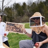 Participants at DePauw University's Earth Day 5K learning about honeybees.