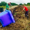 Students processing Grounds Department organic waste into piles