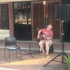 Local musician and EKU student Buddy Tyree plays a familiar cover song for the crowd