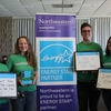 The sustainNU team shares how they conserve energy at the ENERGY STAR® photo booth at Northwestern University's inaugural Earth Day Fair.