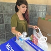 UNLV Take Back the Tap Founder, Monica Garcia, counting bottles collected at a trade in event!