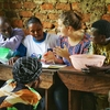 Grace Burleson teaches a group of people in Uganda during her internship.