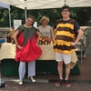 Emory students pose as a bee and tomato at the Emory Farmers Market to highlight the importance of pollinator protection