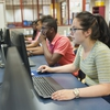 Students utilizing computer labs to access open resource material online.