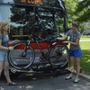 Student Sustainability Educators demonstrate how to load a bike onto a bus