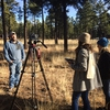 Students Adriana De Alba and Meagan Barbee interview a source for a story on the Mexican gray wolf in Alpine, Arizona.