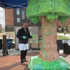 UConn Bakery Manager, Eric Merkle, putting the finishing touches on the life size tree cake at UConn's Earth Day Spring Fling and Arbor Day celebration.
