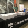 TIger Sustainability Night - EcoRep Erin Mooz '19 hands out Campus Dining mug giveaway