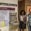 Angela Anima-Korang and Austin Nunn, Southern Illinois University Sustainability Office Team members, uses one of the water bottle refill stations on campus.
