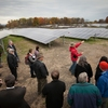 Ole Gustaffson, senior environmental professional for Environmental Local Approvals Resource (ELAR), leads a tour at the 2014 opening of the Cornell Solar Farm on Snyder Road.