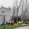 Participants and volunteers at DePauw University's Earth Day 5K.  Community organizations sponsored the distribution of free native Indiana trees, available to all that attended.
