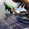 Bates Students install solar panels on the roof of their coastal research facility