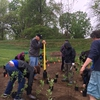 Students, faculty and staff work together on Earth Day to install a student-designed pollinator garden