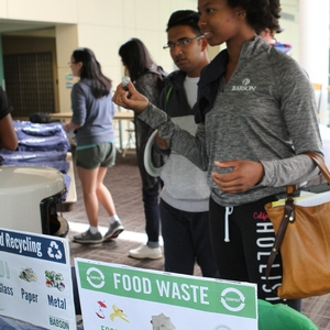 Student at event recycling station