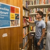 Students look for books at the Connecticut College Lending Library.