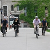 The president of the University of Ottawa and employees from Facilities ride the bikes from the employee bicycle fleet