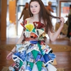One of the models for the Trash Fashion show in a dress made from magazine advertisements.