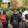 "Judy Bluehorse Skelton during her post presentation entitled ""Re-Indigenizing Cully Park"" on a campus walk talking about plant medicine to students from the Individual Sustainability class."