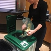 An IUPUI employee uses a compost bin