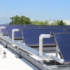 PV Solar panels on the roof of the David Braley Athletic & Recreation Centre are used to heat domestic water for showers, sinks and other fixtures at Mohawk College's Fennell Campus.