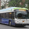 One of Columbia University's new electric buses traveling along Broadway in New York City