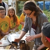 Western Michigan University student demonstrating beekeeping to local elementary school