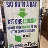 ECOCoin instruction poster located at the UConn Bookstore