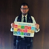 Zach Beaudoin holding up the SDGs