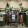 Weighing the Waste at UVM: first-year Environmental Studies major Elizabeth Mackin, sophomore Environmental Science major Lucy McGrew, and sophomore Environmental Studies major Alysa Kelly (from left), both to teach their peers what can be composted, and to learn what messages get results.