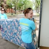 Office of Sustainability staff collect mattresses for recycling after students move out of residences.