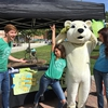 Poly the Polar Bear getting people pumped to fight climate change!