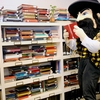 Appalachian State University mascot Yosef peruses the book selection in a promotional photo for the Sustainability Bookstore.