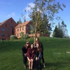 Some members of the winning sorority, Pi Beta Phi, with their willow tree after the planting ceremony