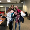 (L-R) Office of Sustainability intern Katie Piel and Outreach Director for the Associated Students of Madison (ASM) Sustainability Committee, Madalynne Bridge, hold piles of clothing donated for the ASM Clothing Swap, held during Earth Week on the UW-Madison Campus.