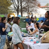Students talk to vendors about their work in the Atlanta community