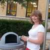 Students taking GPS data point of an on campus receptacle.