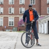 Urbana campus Chancellor Robert J. Jones tests out his borrowed bicycle before embarking on a ride around campus alongside more than 30 students, staff, faculty, and community members.