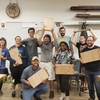 Group of students presenting their finished cutting boards (Fall 2019).