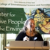 "Robin Kimmerer, Distinguished Teaching Professor and director of the ESF Center for Native Peoples and the Environment, spoke during a ceremony at which ESF formally recognized its location on the original territory of the Haudenosaunee Confederacy. The event, called ""Where We Stand,"" was followed by a workshop to discuss environmental alliances between ESF and Indigenous Peoples."