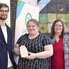 Daniel Kielback (left) and Destyni DeLuca (centre) receive and award on behalf of Sustain SU, a student organization that offers many programs to advance sustainability on campus.