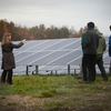 Sustainability Management Specialist Sarah Zemanick (SUST) leads a tour at the 2014 opening of the Cornell Solar Farm on Snyder Road.