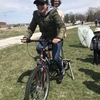Making a bike-powered smoothie at the Iowa Physicians for Social Responsibility Earth Day event in Iowa City