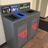 "The University of Dayton places composting and recycling bins outside dining facilities on campus to encourage composting and recycling and diverting ""trash"" from landfills."