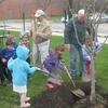 Roosevelt University (RU) plants a tree for their Arbor Day Observance. Kids, from the Bright Horizons Daycare (located on RU's Schaumburg Campus), and RU tradesmen, staff, students, and RU's arborist participated.