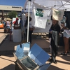 Student volunteer, Cheerie Patneaude, and our solar cooker