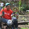 Jorge Luis Godines Perez, one of the farm owners of the Unión de Cafetaleros Orgánicos de Ángel A. Corzo (UCOAAC) coffee cooperative, with his son.